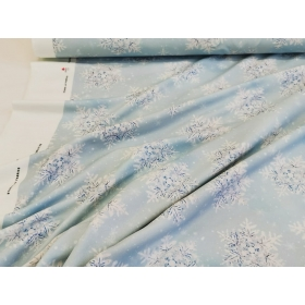 French Terry snowflakes in light blue